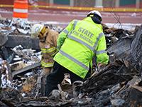 Photo of a fire investigator at a fire scene.